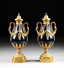 A PAIR OF SÈVRES STYLE DORÉ BRONZE MOUNTED COBALT BLUE GROUND PORCELAIN URNS, 20TH CENTURY,