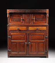 AN 18TH CENTURY CARVED OAK COURT CUPBOARD, ENGLAND, CIRCA 1723,
