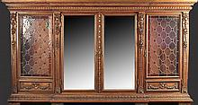 A RENAISSANCE REVIVAL CARVED WALNUT AND STAINED GLASS BOOKCASE/CABINET, EARLY 20TH CENTURY,