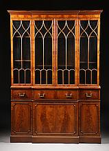A GOTHIC REVIVAL STYLE CARVED WALNUT BREAKFRONT SECRETARY CABINET BY THE TIBBENHAM FURNITURE CO., IPSWICH, ENGLAND, LATE 20TH CENTURY,