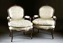 A PAIR OF LOUIS XV STYLE CARVED CHESTNUT FAUTEUILS, 19TH CENTURY,