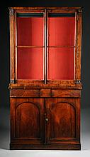 A REGENCY CARVED ROSEWOOD BOOKCASE CABINET, EARLY 19TH CENTURY,