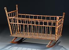 AN AMERICAN BRAND IRON DECORATED BAMBOO BABY CRADLE,
