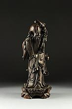 A CHINESE CARVED HARDWOOD FIGURE OF A SAGE IMMORTAL, 20TH CENTURY,