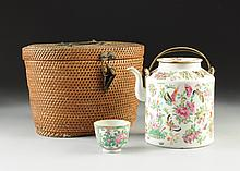A ROSE MEDALLION TEAPOT AND CUP SET WITHIN A FITTED WOVEN BASKET, 19TH CENTURY,