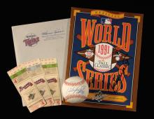 Kirby Puckett autographed 1991 World Series baseball and program with related material. Rawlings F.Vincent Official 1991 World Series game logo baseball has been signed on the sweetspot,