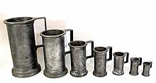 Set of seven pewter measuring cups