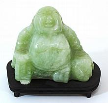 Carved jade figurine of a Buddha