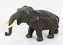 Bronze figurine of an elephant with ivory tusks