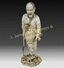 Japanese Carved Okimono Figure, 19th C.