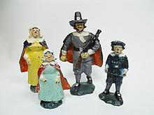 Collection of Four Cast Iron Pilgrim Figurines