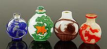 Four Chinese Carved Peking Glass Snuff Bottles
