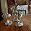 A pair of silver plated table centrepieces formed