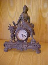 Beautiful designed French spelter cased wind up clock with beautiful girl