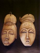 Pair of antique carved  ivory masks