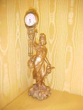 Spelter figural swinger clock