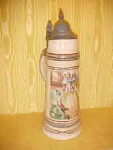 Tall porcelain stein with pewter lid