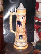 Large German porcelain stein with pewter lid