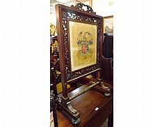 A Victorian Mahogany Framed Fire Screen, the