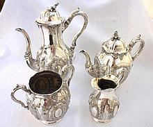 A late 19th/early 20th Century Four Piece Silver