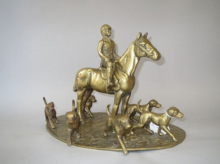 Solid brass table model of a huntsman with hounds
