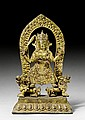 A GILT BRONZE FIGURE OF DURGA STANDING ON TWO LIONS. Nepal, 18th c. Height 38.5 cm.