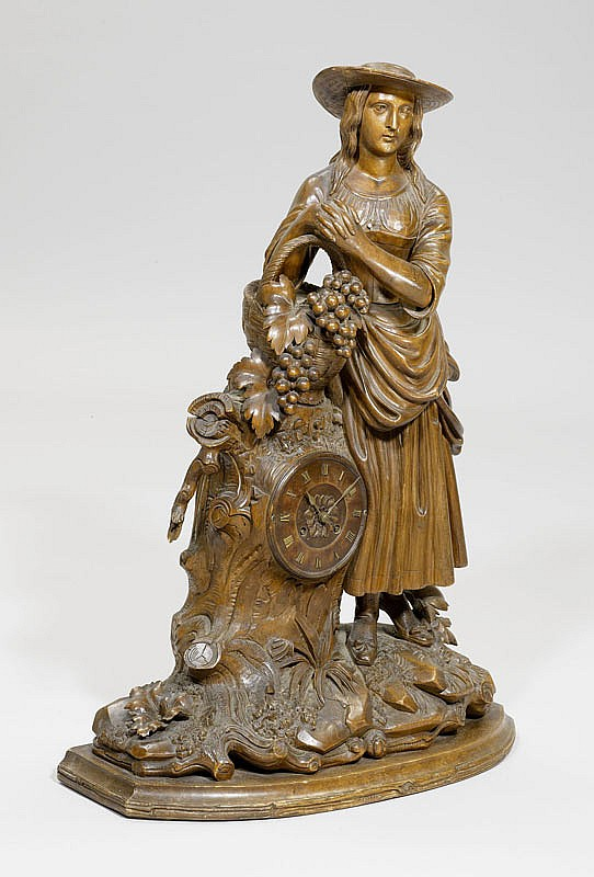 A CARVED CLOCK, Brienz or Black Forest, mid 19th