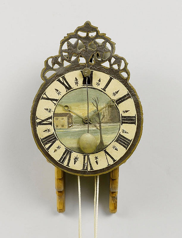 A BAROQUE IRON CLOCK, Switzerland or Southern