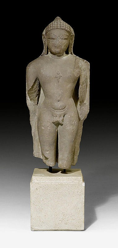 A RED SANDSTONE FIGURE OF A JINA IN STANDING MEDITATION. Rajasthan/Madhya Pradesh, 9th/10th c. Height 59 cm.