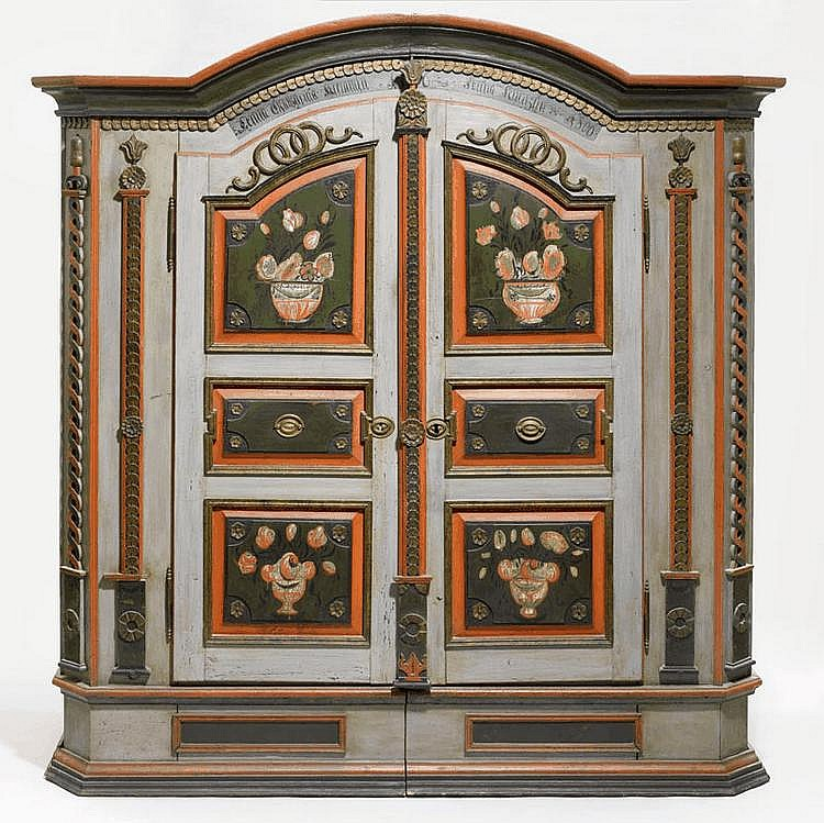 A PAINTED AND CARVED PINE CUPBOARD, Austria,