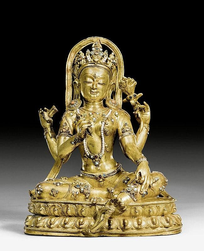 A MAGNIFICENT GILT COPPER FIGURE OF A FOUR ARMED