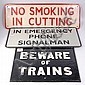 A cast iron 'Beware of Trains' sign, company