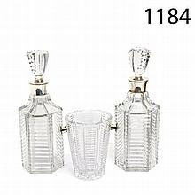 Glass and silver decanters and ice bucket