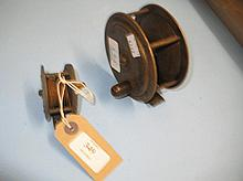 19th Century brass wooden handled fishing reel and