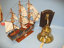 Model of H.M.S. Endeavour and a brass reproduction