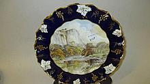 Royal Crown Derby plate painted with a view of Hig