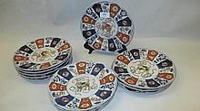 Set of twelve Imari plates, the centres decorated