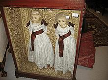 Two large 19th Century wax dolls with later clothi