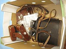 Two cased pairs of binoculars, a cased Agfa camera