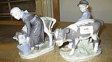 Pair of Royal Copenhagen figure groups of a boy an