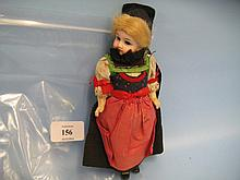 Small German bisque headed doll with sleeping eyes