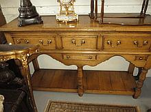 Good quality reproduction oak dresser base with th