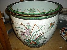 Large 20th Century Chinese porcelain jardiniere with incised and painted flower inset and fish decoration together with a hardwood stand
