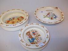 Mid 20th Century Royal Doulton Bunnykins warming dish and cover together with two similar babies plates