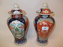 Pair of late 19th / early 20th Century Chinese baluster form vases and covers with enamel floral decorated panels and covers (chip to one cover), 12ins high