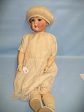 Limbach bisque headed doll with sleeping eyes and open mouth with four teeth on a jointed wooden and composition body wearing a silk and lace work dress, impressed mark crown above a shamrock, Limbach, made in Germany, 24ins high
