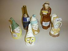 Collection of six modern Royal Worcester candle extinguishers, ' Mr Caudle ', ' Al ', ' Punch Young ', ' Girl ', ' Mrs Caudle ' and ' Monk Reading ', together with another in the form of a bottle of Champagne commemorating the Millenium