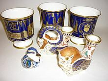 Pair of Royal Crown Derby imari pattern candlesticks, similar paperweight in the form of a duck and three cobalt blue and gilt Limited Edition goblets