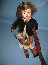 German bisque headed doll with jointed body in Highland dress, 11ins high