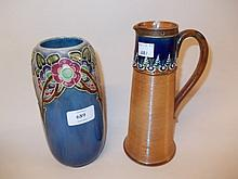 Royal Doulton floral relief moulded stoneware vase and a Royal Doulton jug vase